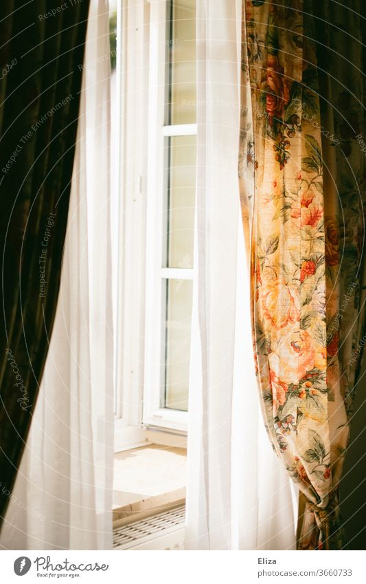 Opened window with curtains and flowered curtains drapes Window open Floral Flowery pattern Ventilate Sunshine Light aerate Flat (apartment) Curtain Drape