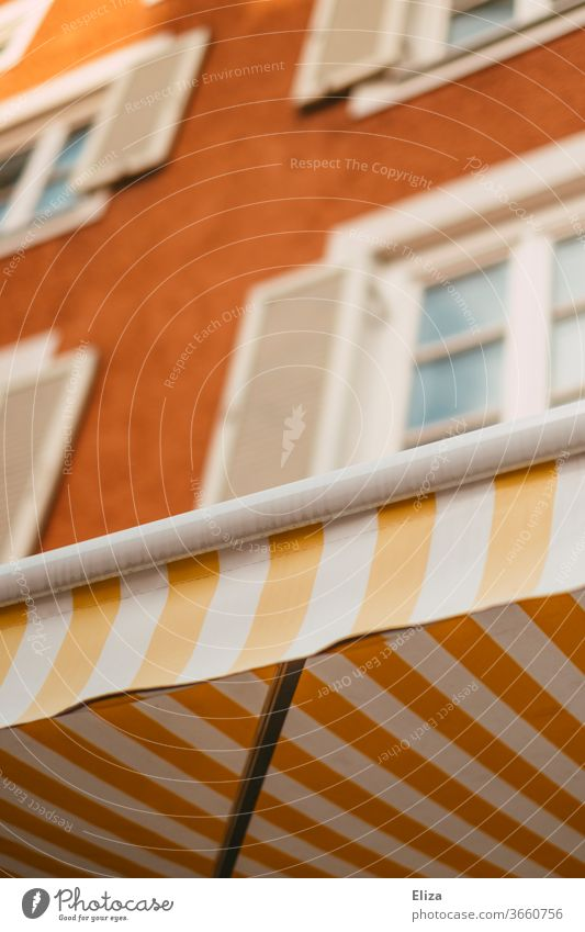 Yellow and white striped awning on a pretty facade Sun blind White Striped Facade kind Old building Window built House (Residential Structure) Old town