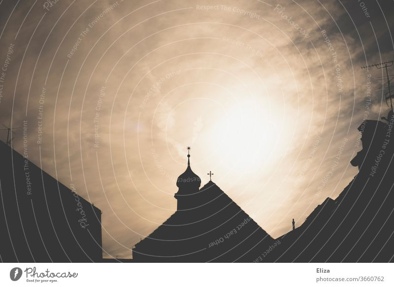 Silhouette of a church with a steeple against the light Church Church spire house of God Belief Religion and faith Christianity Back-light impressive Holy