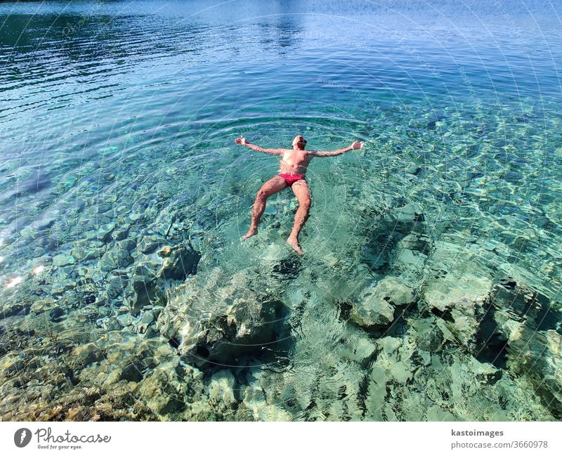 Man relaxing on vacation, floating in calm tourquoise sea. Float in the water Ocean Summer Swimming & Bathing Vacation & Travel Beach Tourism Turquoise Bay