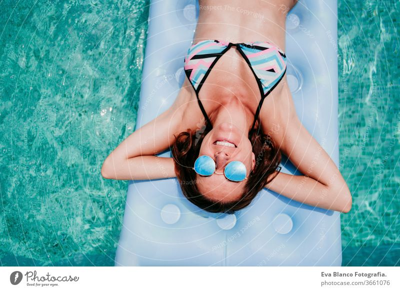 happy woman on inflatable having fun. Summer time. top view swimming pool summer blue water relax hat sexy lifestyle sunglasses swimwear hot body tanning spa