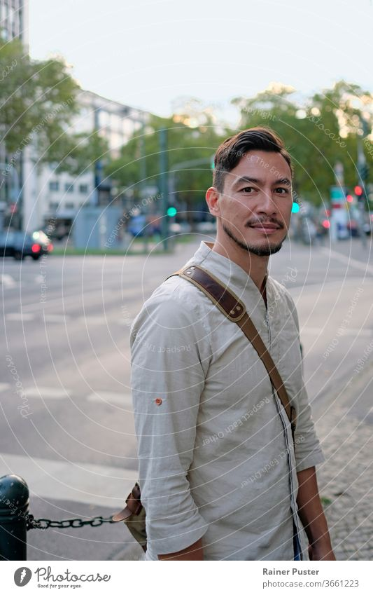 City life: Handsome man standing next to a road in the afternoon hours adult city confident fashion friendly guy handsome happy lifestyle looking male men
