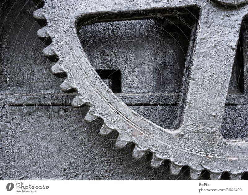 Gear wheel on a historical machine. Gear unit Gearwheel gearing gearbox Mechanics technique Machinery pinion spur gear dovetail cogwheel gearwheel clockwork