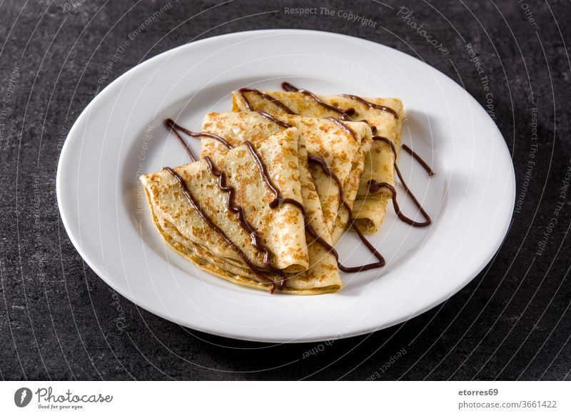 Sweet crepes with chocolate on black background Crepes blinis breakfast cocoa delicious dessert dough food fresh homemade pastry plate recipe russian slate