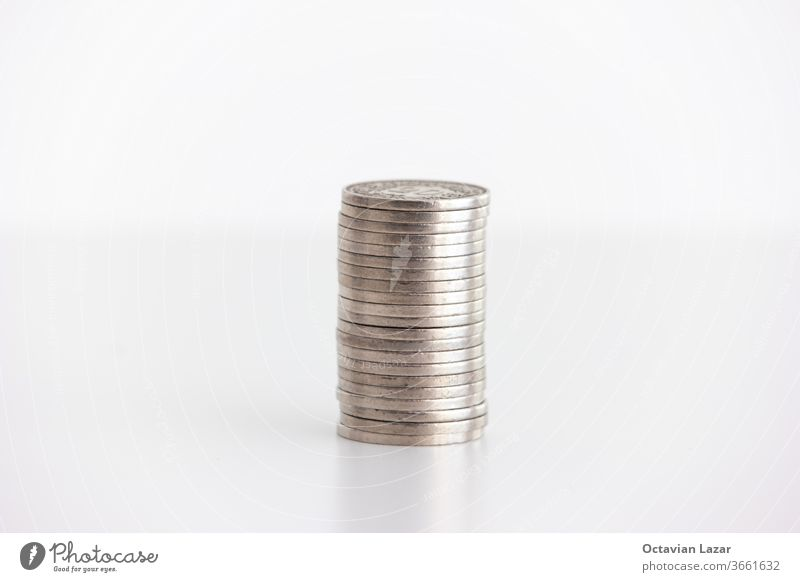 Stack of stainless metal generic currency coins set on table frontal shot isolated on white background money investment profit rich concept stack cash stock
