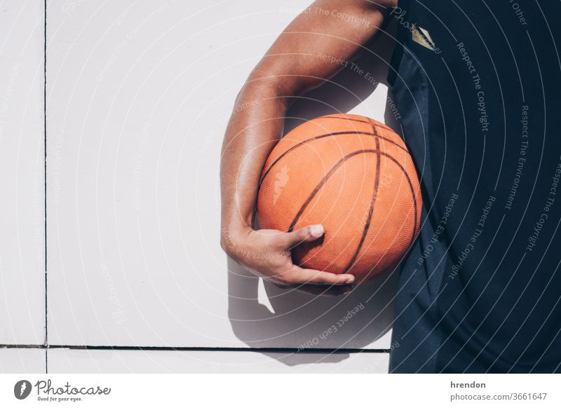 young man holds a basketball sport competition game athletic competitive play playing exercise male exercising effort hobby match practicing sporting
