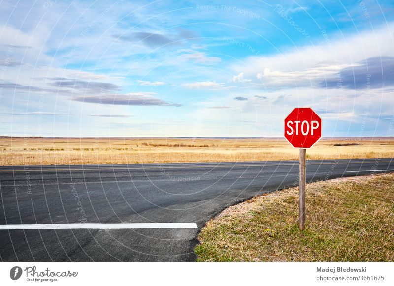 Stop road sign at an intersection in Badlands National Park, USA. stop travel trip highway nature landscape rural South Dakota freedom scenery adventure horizon