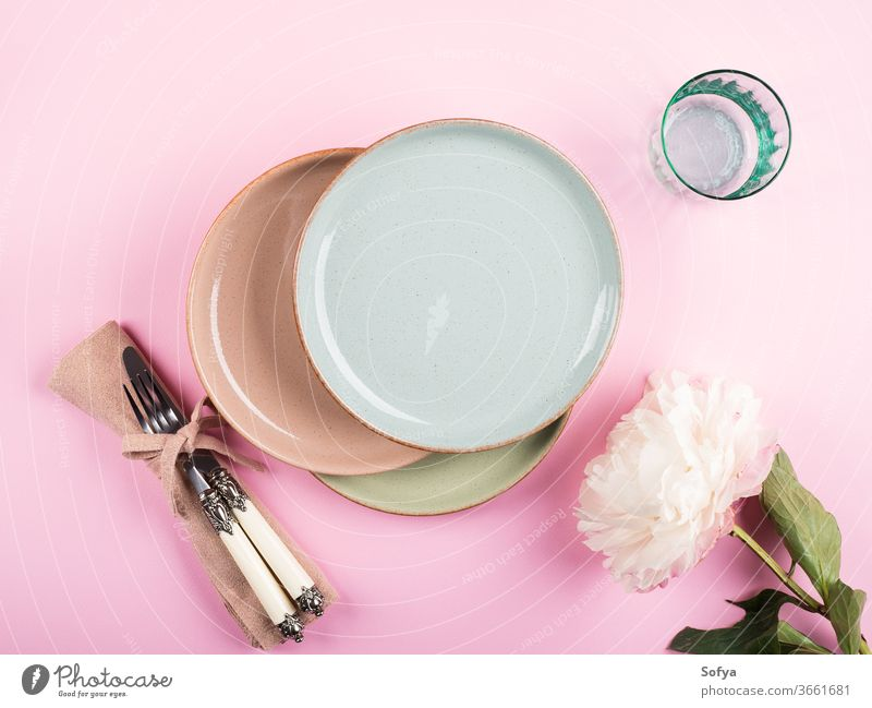 Pastel color dishes on pink tableware crockery pastel ceramic flower background dinnerware dishware design kitchenware set food summer spring plate party cup