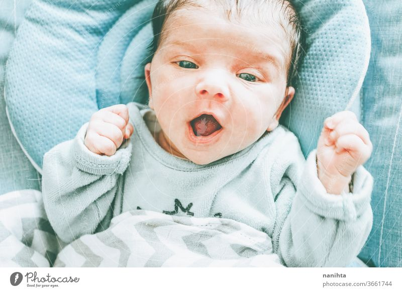 Lovely newoborn caucasian girl baby face cute new born newborn child birth first month boy family daughter son lovely adorable real tired sleep calm quiet lying