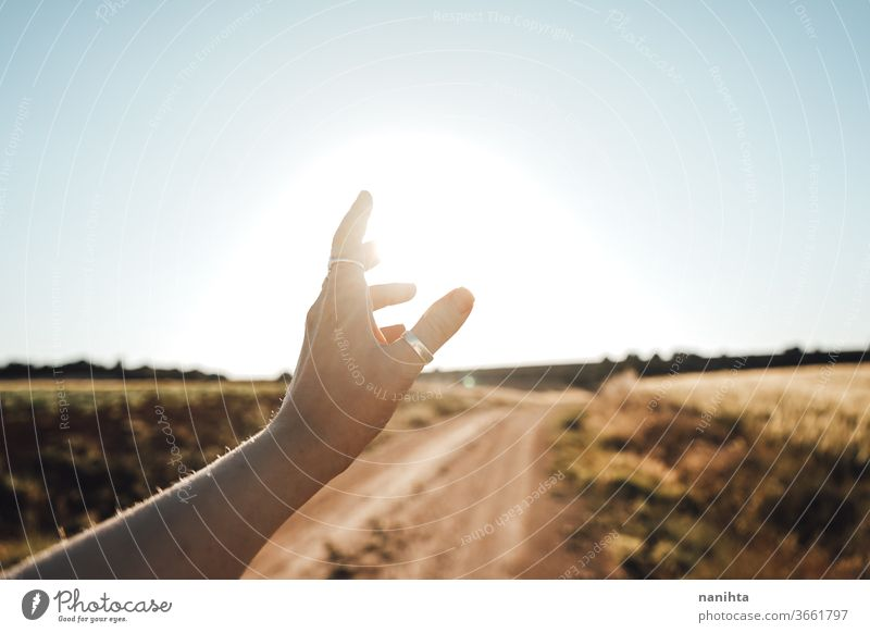 Arm raised near the sun ligth hand backlight sunset sunrise beautiful warm poetry calm quiet nature touch sunny summer fall autumn warm touch vintage happy
