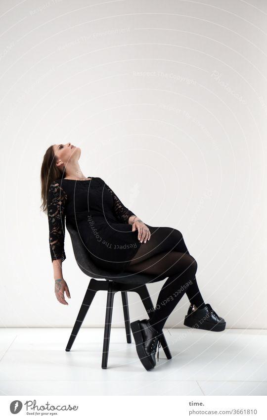 On set (2) temporising portrait actress Meditative Head Dress hair feminine Woman arm Concentrate Artificial light Chair Sit Upward Footwear Leaning back