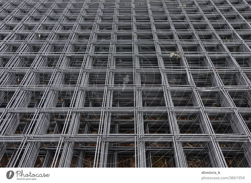 steel mesh panels used in construction reinforcement abstract industrial background squares pattern reinforcing welded iron grid framework metal equipment wire