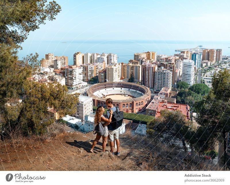 Romantic couple enjoying picturesque cityscape of Malaga embrace scenery wonderful seascape malaga viewpoint romantic spain scenic peaceful wanderlust carefree