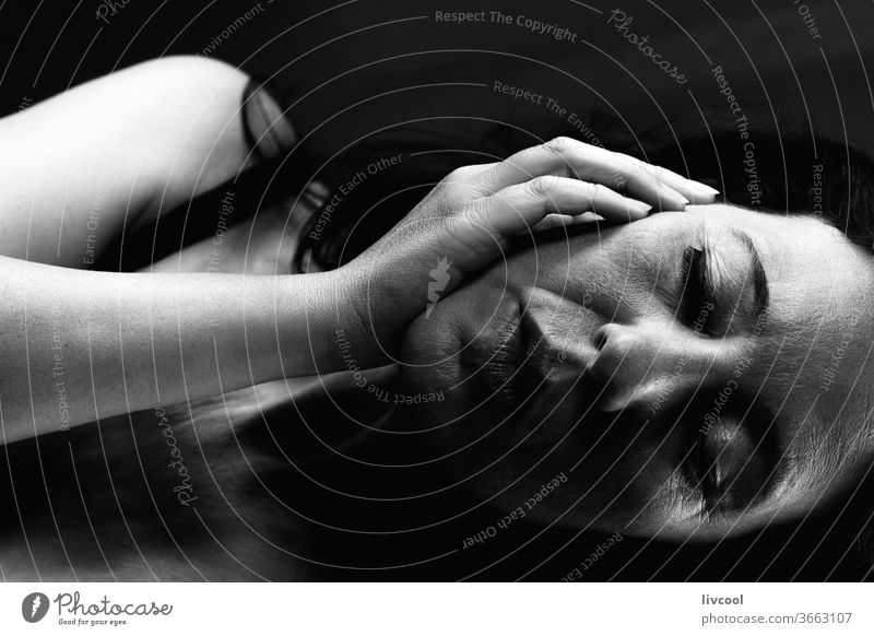 black and white woman profile portrait III beautiful lying down sad attitude dark tumble black background people romantic romantic attitude brown one people