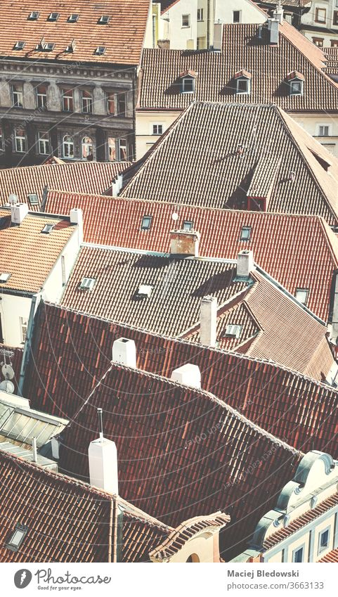 Roofs of Prague, retro toned picture, Czech Republic. city roof architecture old building house aerial from above tile urban Europe filtered vintage faded