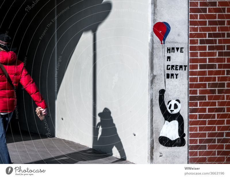 The Panda with the balloon wishes you a nice day Balloon Graffiti Wall (building) Human being Shadow Red Hat Breakfast Tunnel Entrance brick Wall (barrier) Town