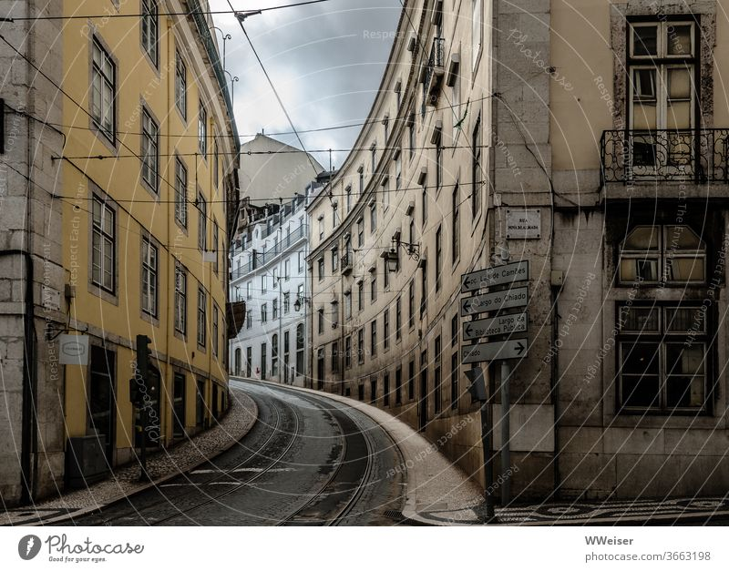 Empty street in Lisbon Street Curve Portugal Town Vacation & Travel Tourism Capital city City trip Tram Railroad tracks Deserted Rainy weather Signs houses