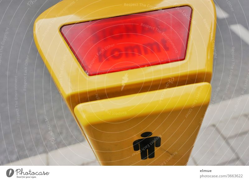 "She hopes that HE will finally send a signal - ""SIGNAL is coming"" is illuminated at the yellow traffic light button Traffic light push button Signal coming"