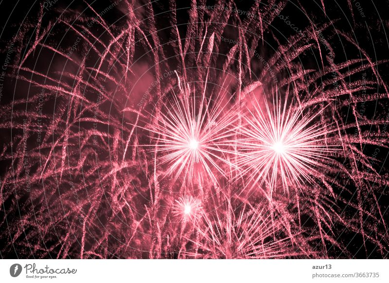 Luxury fireworks event sky show with red big bang stars. Premium entertainment magic star firework at e.g. New Years Eve or Independence Day party celebration. Black dark night background