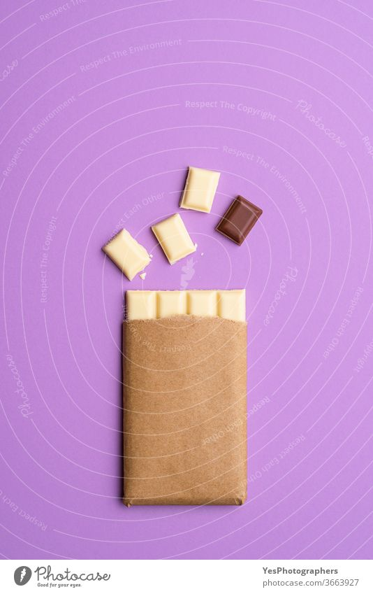 White chocolate bar in pieces. Milk chocolate square. Top view background broken brown christmas chunk cocoa comfort food concept confectionery copy space