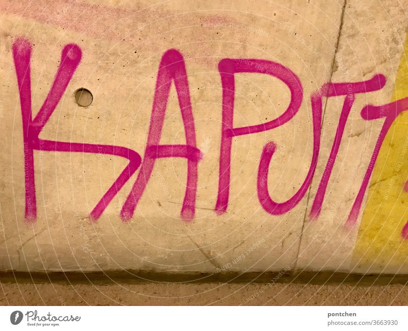 The word broken is written in pink as graffiti on a wall Broken Word Letters (alphabet) Graffiti Characters Wall (building) Day Destroy exhausted Youth culture