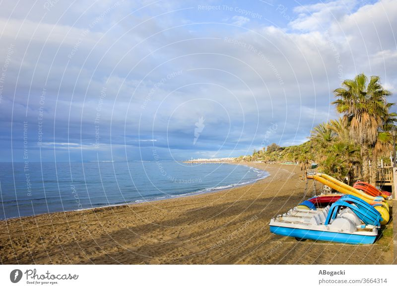 Sea beach with paddle boats on Costa del Sol in Marbella, Andalusia, Spain spain marbella costa del sol vacation sea holidays leisure travel tourism europe