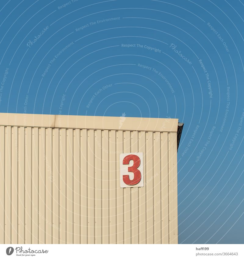 the red three at the storage shed 3 number Digits and numbers Sign Signs and labeling House number Wall (building) Characters Warehouse warehouse Flake