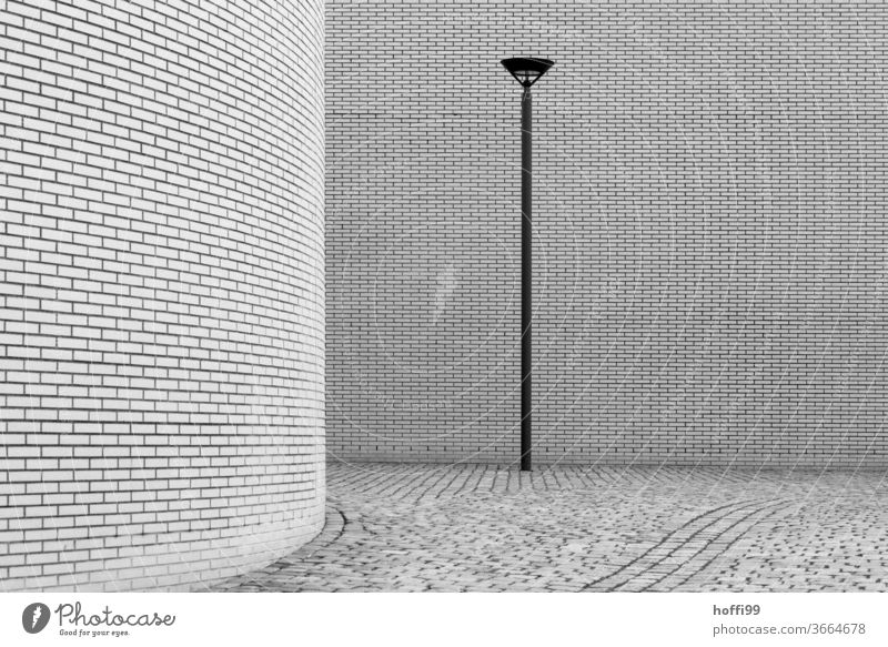 the lamp brings enlightenment - the rounding hides, but the whole thing is a boon to the viewer of minimalist scenes Lantern Lamp post Wall (building)
