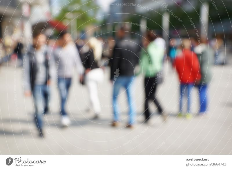 defocused city people blur crowd urban street background pedestrian walk shopping downtown men women blurry blurred out of focus abstract scene life lifestyle