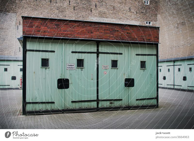 friendly multi-purpose garages from DDR times Garage Architecture Multi-purpose garage GDR Turquoise Prenzlauer Berg Fire wall Garage door Retro Ravages of time