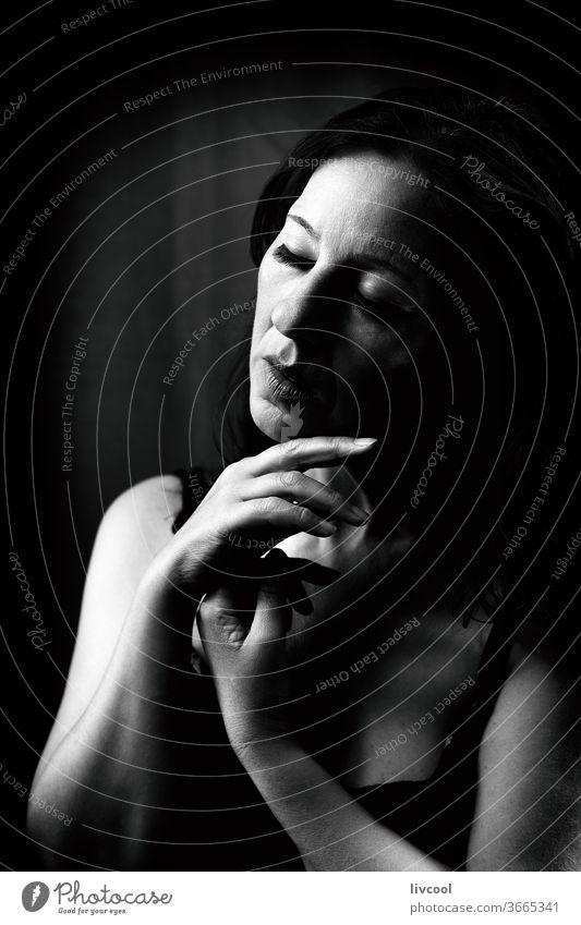attractive mature lady, spain - europe portrait beautiful black and white profile sad attitude dark black background woman people romantic romantic attitude