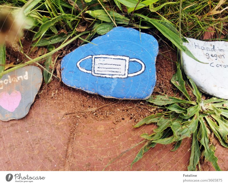 Small messages - or a mouth-nose guard painted on stone Helgoland Stone stones Colour Painted Work of art writing Letters (alphabet) corona Mouth and nose mask
