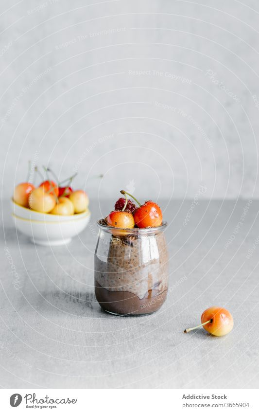 Delicious chocolate chia pudding with white cherries on top dessert organic breakfast berry seed white berry jar glass sweet delicious food natural nutrition