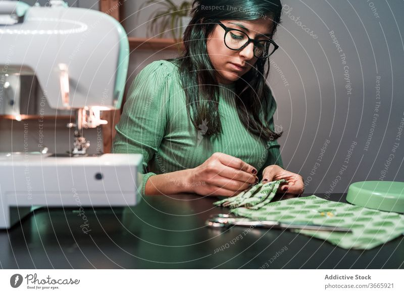 Tailor sitting in table using needles to stitch face masks woman atelier sewers needlewoman clothes designer fashion textile seamstress sewing tailor craft