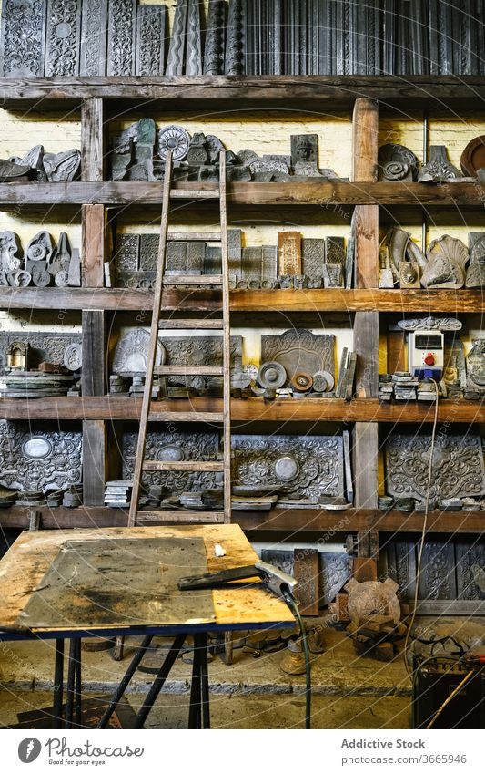 Jewelry workshop with metal details on shelves jewelry goldsmith shelf craft production grunge tool various equipment assorted weathered collection storage