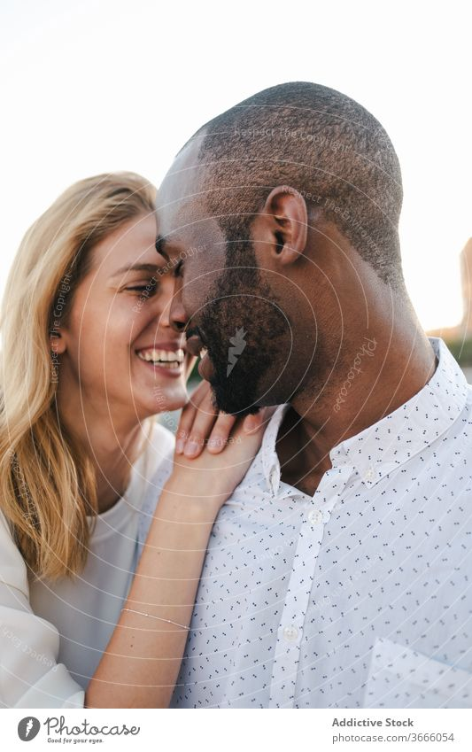 Tender multiracial couple hugging each other lovingly bonding rest in love romantic content tender sensual eyes closed cuddle happy cheerful fondness affection