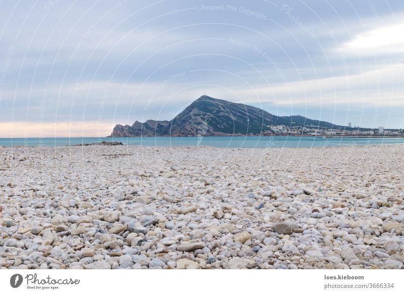 Panorama sunset with colorful cloudscape at the stone beach of Altea, Costa Blanca, Spain altea coast ocean spain sky sea view landscape vacation nature tourism