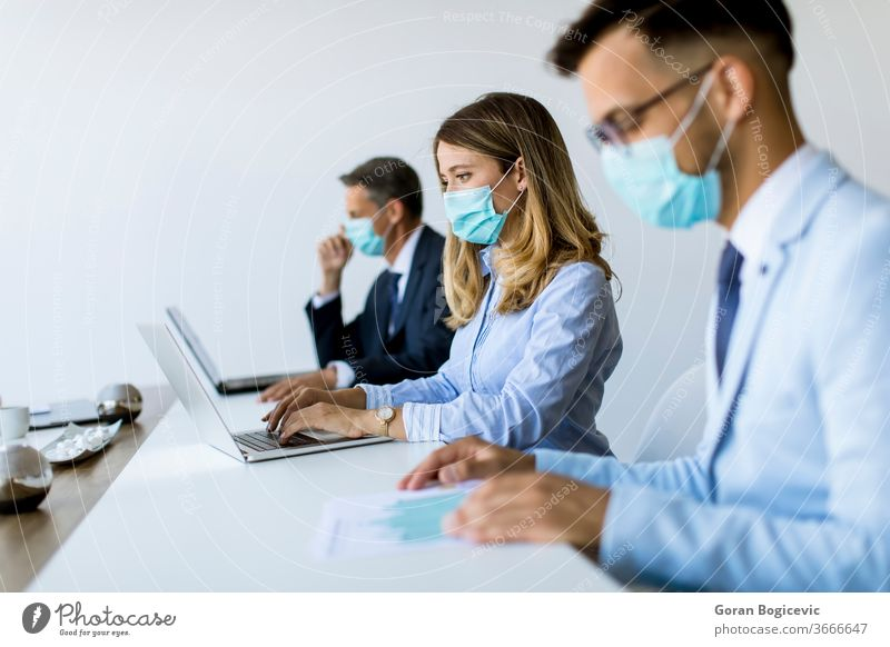 Group of business people have a meeting and working in office and wear masks as protection from corona virus brainstorming businessman businesswoman care