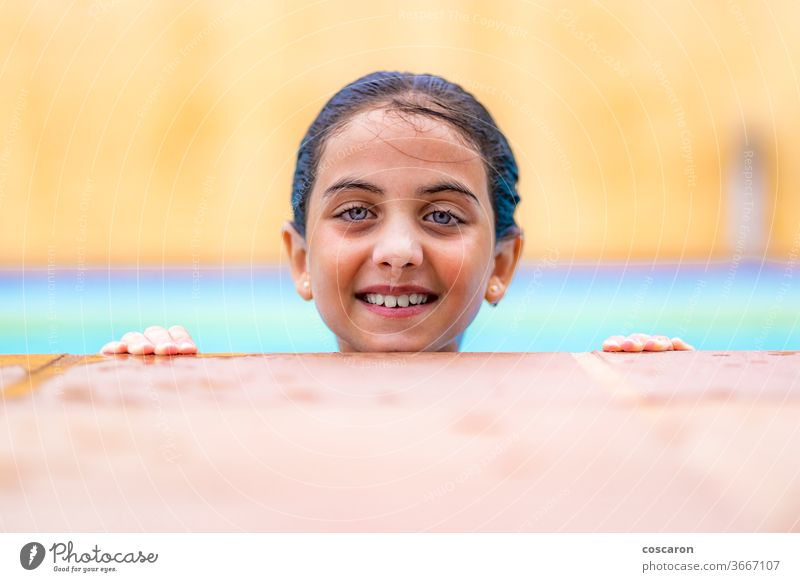 Little girl into the water on a pool´s edge active activity adorable beauty caucasian child childhood colorful cute day enjoyment face fun funny happiness happy