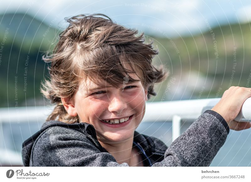 Stormy times Brash long hairs Colour photo Family Close-up Child Boy (child) Infancy Face Day Light Contrast portrait Sunlight Hair and hairstyles Mouth Lips