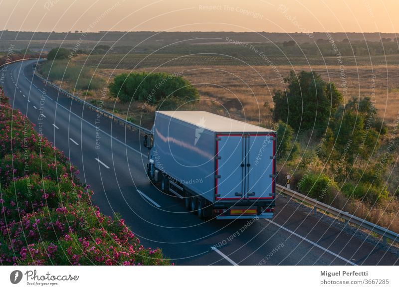 Truck with refrigerated semi-trailer driving on the highway truck road transportation perishable fruit transport controlled temperature cargo travel traffic