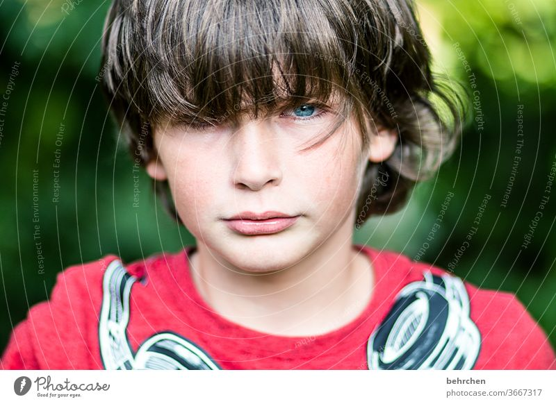 I can also be different Exterior shot Son Child Sunlight portrait Close-up Cool (slang) Contrast Light Brash long hairs Day Face Infancy Colour photo Family