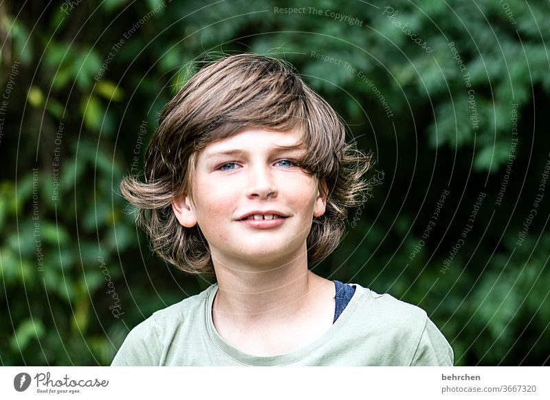 ah, a haircut is overrated.... Cool (slang) Brash long hairs Colour photo Family Light Day Face Infancy Boy (child) Child Close-up Contrast portrait Sunlight