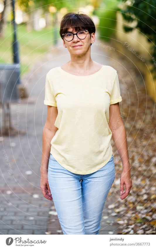 Beautiful Middle-aged woman walking down the street female 50s outdoor mockup cute lifestyle casual caucasian single sitting beautiful leisure person eyeglasses