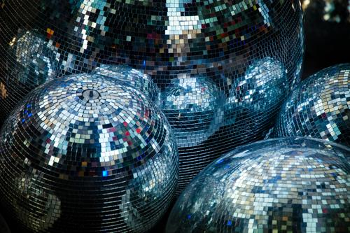Disco bullets... 1. a lot of shiny disco balls next to each other on earth. Disco balls Light Leisure and hobbies Party Club Dance Feasts & Celebrations Music