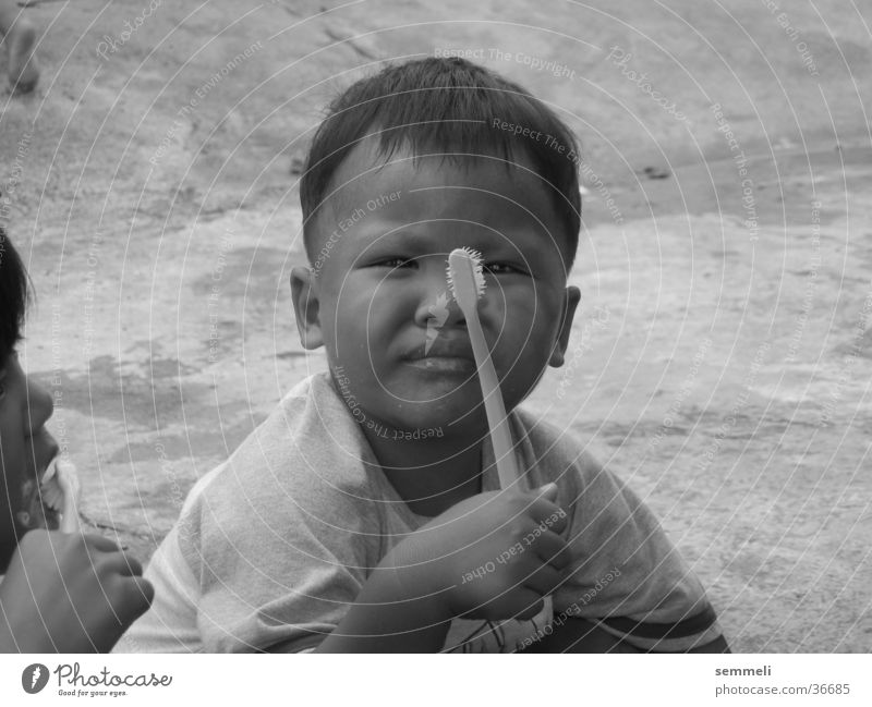 Child with toothbrush Toothbrush Thailand Boy (child) Man Poverty Teeth