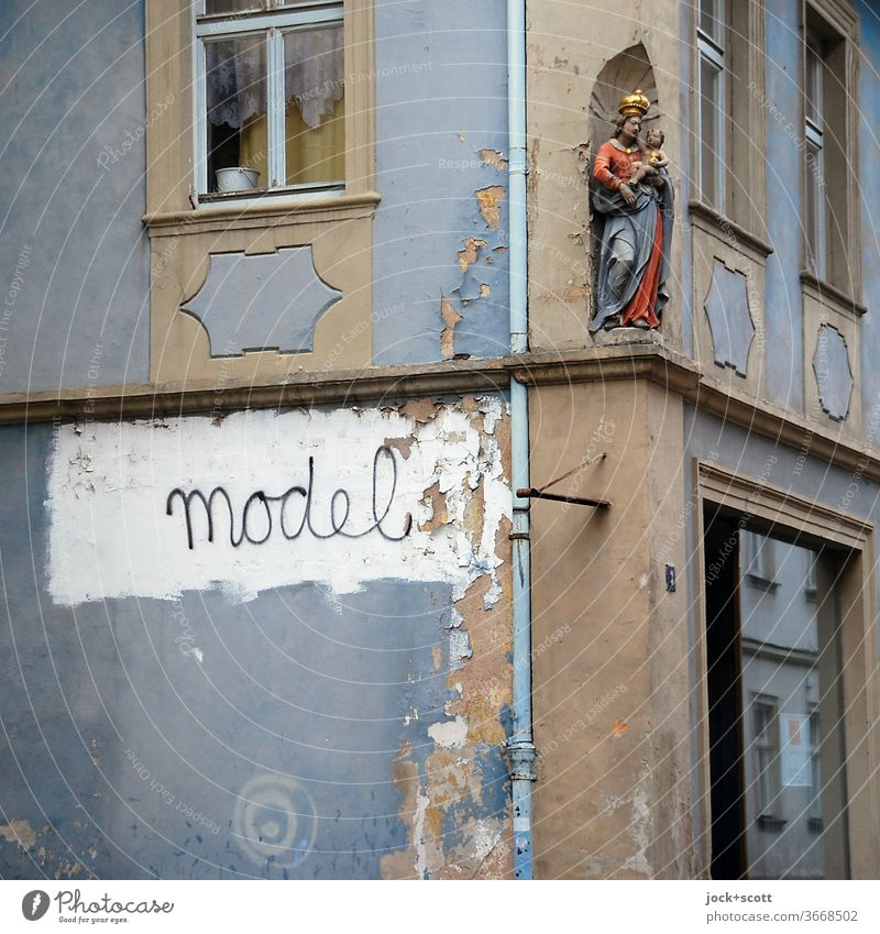 Model figure for an eternity Facade Corner Window Architecture Decoration Word Religion and faith Weathered Spirituality Holy figure Sculpture Street art
