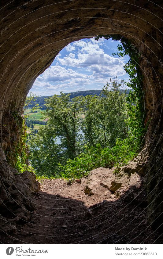 View from a cave at the Happurg reservoir mountains Cave rocky Summer Hiking Nature Mountain Landscape Rock Tourism Vacation & Travel Exterior shot Trip