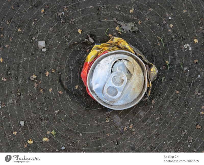 A flattened beverage can from a bird's eye view Tin Beverage Trash Metal Aluminium Deposit on cans Close-up Recycling Thirst Day Environmental pollution Dirty