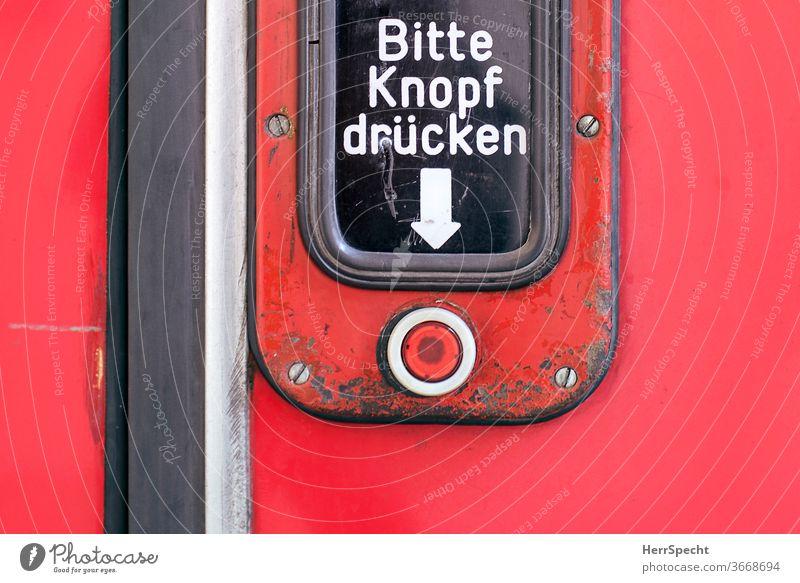 "Tram door - ""Please press button"" push button Pressure button press Key open Characters invitation Arrow Mechanism Signage Red Letters (alphabet) Public transit"